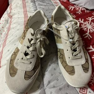 CoAch cream and tan sneakers